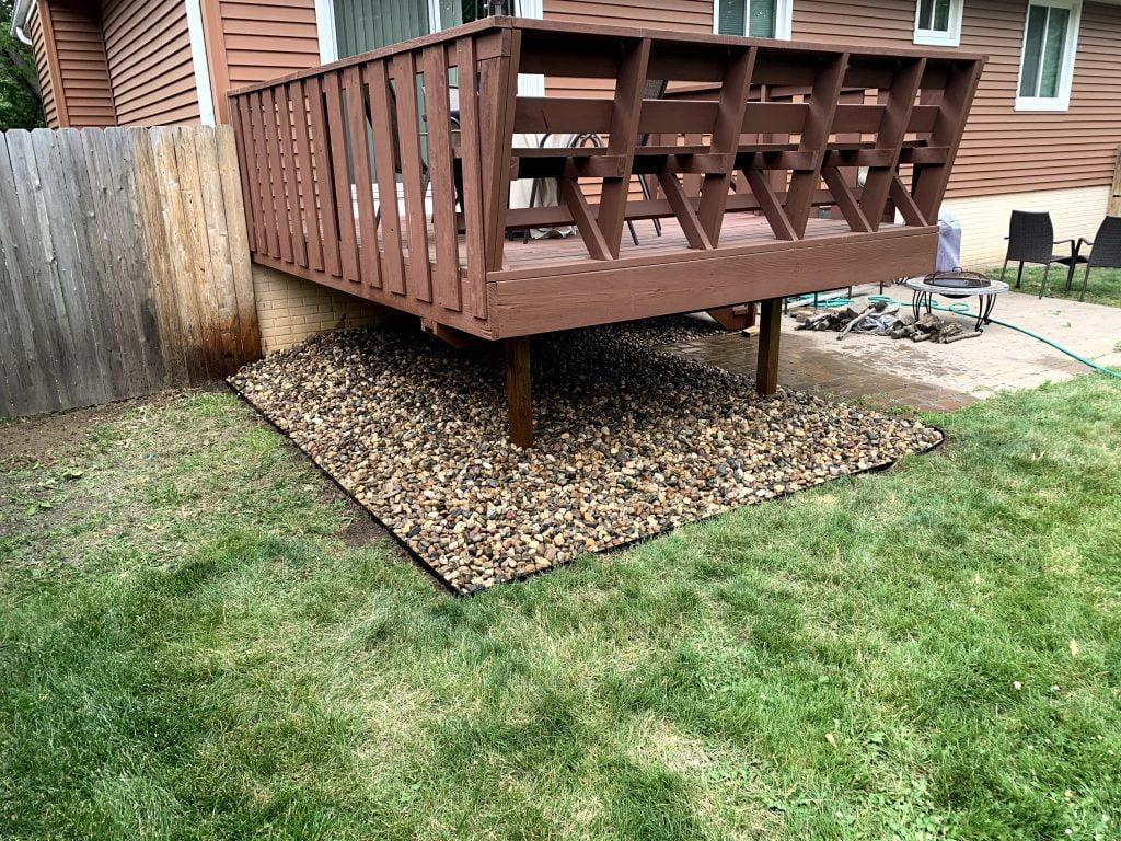 River rock by patio landscaping Papillion Nebraska