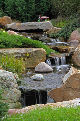 Pondless waterfall in backyard Omaha Nebraska