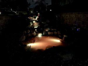 Koi pond with lights at night Omaha Nebraska