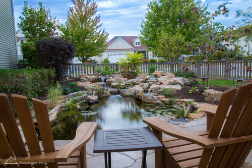 Enjoy koi pond by patio Omaha Nebraska