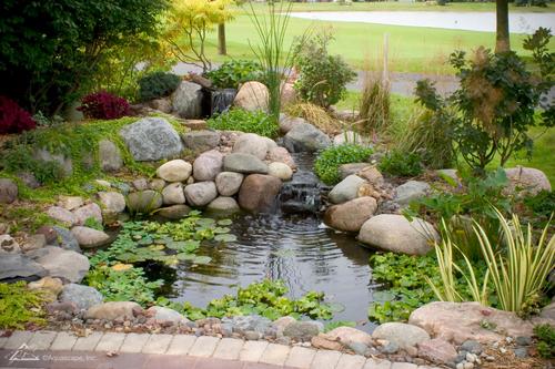 Small backyard pond in landscaping Omaha Nebraska